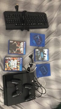 Sony PS4 console with controller and game cases Wilmington, 19809