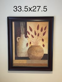 white and brown vases painting and black frame
