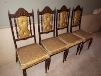 brown wooden framed brown padded chairs
