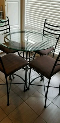 EUC Counter height glass dining table and 4 chairs 546 km