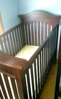 baby's brown wooden crib Bolingbrook