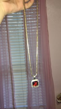 gold-colored and ruby necklace