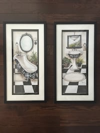 two white wooden framed painting of flowers King