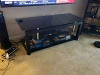 black metal framed glass top TV stand 57 km