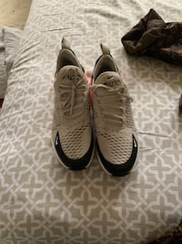 pair of black-and-white Nike running shoes Baltimore, 21217