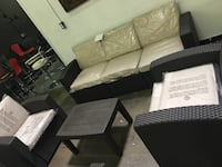 4 pieces outdoor patio set. (Sofa, 2 Chairs and Table)Brand new.  Garland