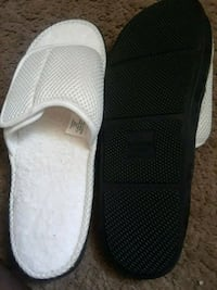 pair of black-and-white slip on shoes Naples, 34102