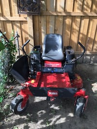 red and black Toro zero turn mower 545 km