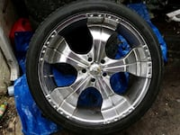 chrome 5-spoke car wheel with tire 51 km