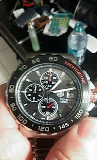 round black and red chronograph watch with black strap