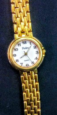 round gold-colored analog watch with link bracelet El Paso, 79902