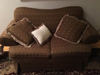 brown fabric 2-seat sofa with throw pillows and chaise  purchased from Decor Rest