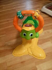 green and yellow riding toy turtle