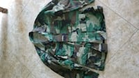 green, brown, and black camouflage jacket