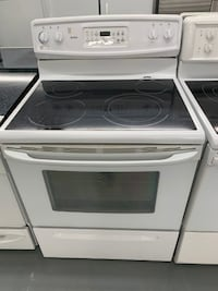 White Kenmore glass top stove Montreal
