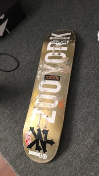 brown and gray wooden skateboard deck