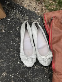 pair of white leather flat shoes