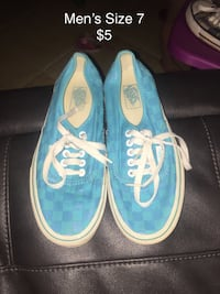 pair of size 7 teal-and-white Vans sneakers with text overlay Rome, 30161