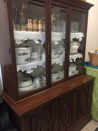 Brown wooden and glass shelving cabinet Toronto, M6H 0H3