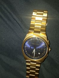 round gold-colored chronograph watch with link bracelet 27 km