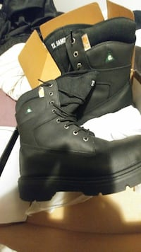 pair of black leather boots Salaberry-de-Valleyfield, J6S 3J2