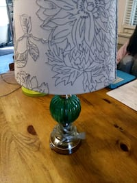 two green and white table lamps