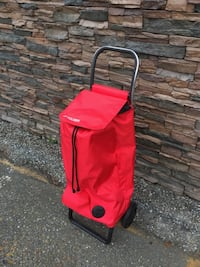 red and black travel luggage Abbotsford, V2T 2H4
