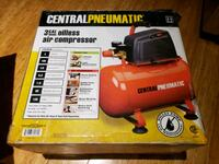 red and black Central Pneumatic air compressor box
