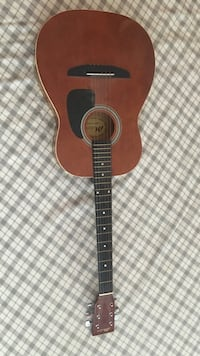 black and brown acoustic guitar 788 km