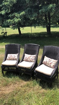 two brown wooden framed padded armchairs Canton, 48188