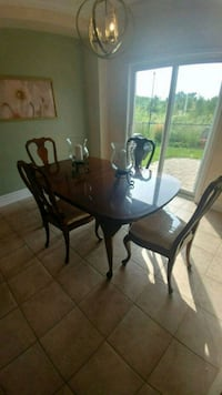 oval brown wooden dining table with 4 chairs set Richmond Hill, L4E 3P5