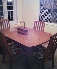 brown wooden rectangular 4 chairs dining set