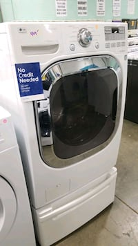 Lg front load washer machine 27inches.  Queens