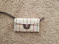 beige, red, and black leather tattered wristlet