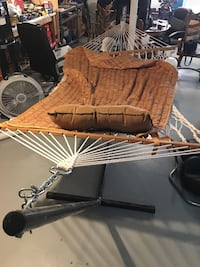 white and brown net hammock with blanket and pillow
