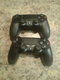 black Sony PS4 game controller