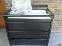 Changing table with diaper holder