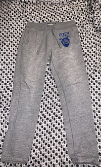 M Light Grey Abercrombie & Fitch sweatpants w/ blue patch and letters