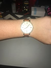 round white analog watch with silver link bracelet