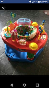baby's red and blue activity saucer Calgary, T3A 2H4