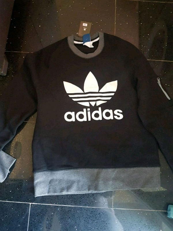 sports shoes fe7a4 62a65 Used black and white Adidas crew-neck sweater for sale in Tipton - letgo
