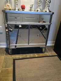 Mirrored and silver entrance table with drawers. BRAND NEW IN BOX!! Retail $700+ Brand new in box $500 to first pickup.