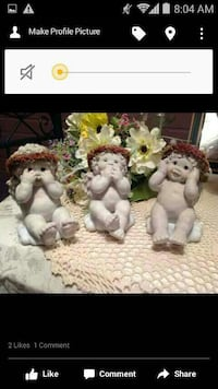 three cherubs ceramic figurines screenshot