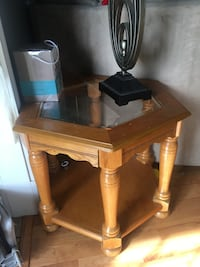 octagonal brown wood-frame glass-top side table