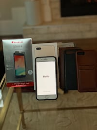 Almost new gold 128 GB iPhone 7 Plus with Invisible Shield Glass+ protector and 3 leather cases.  Raleigh, 27607