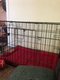 Small-medium crate with king dog bed. Pick up only Thornton, 80241