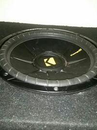 black and gray Kicker subwoofer 867 mi