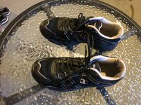 Pair of black-and-white running shoes size 10
