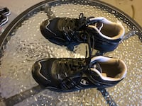 pair of black-and-white Nike running shoes 1960 km