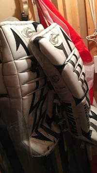 white-and-black leather goalie pads
